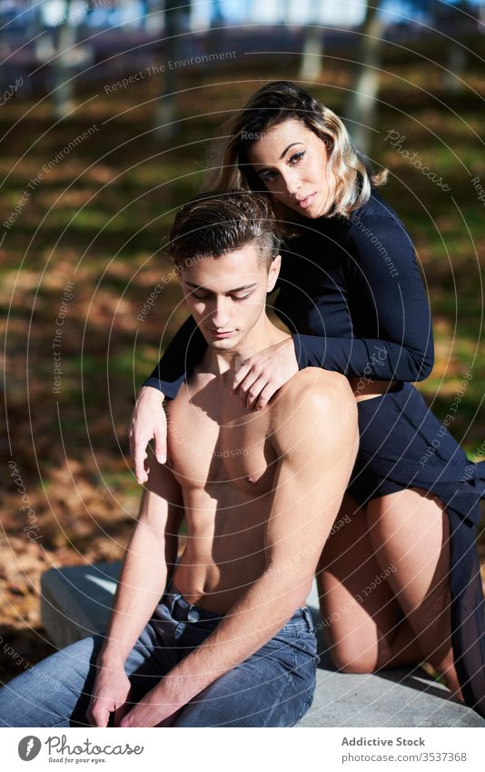 Calm couple having rest in park sensual relax lean together woman tender peaceful gentle calm attractive romantic blouse lifestyle outdoors young relationship