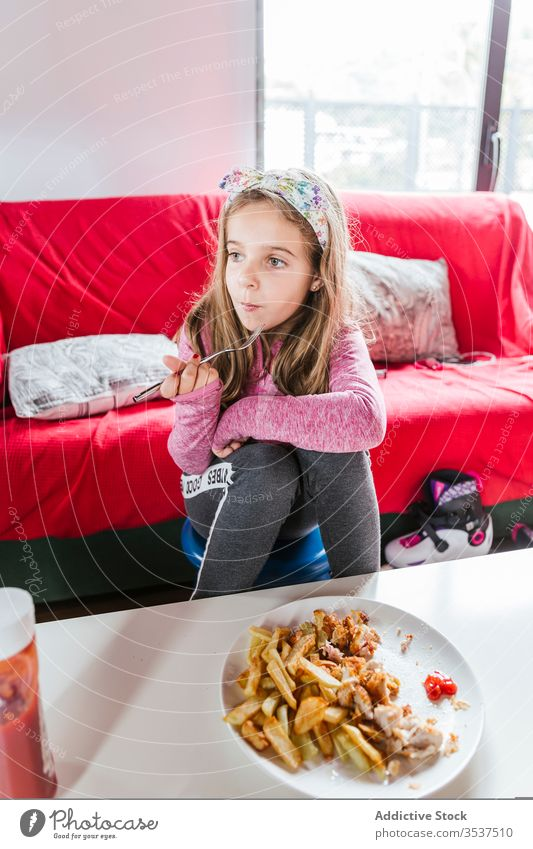 Girl eating lunch meal at home girl dinner living room food sofa sit rest casual tasty dish kid child nutrition yummy cozy lifestyle relax delicious comfort