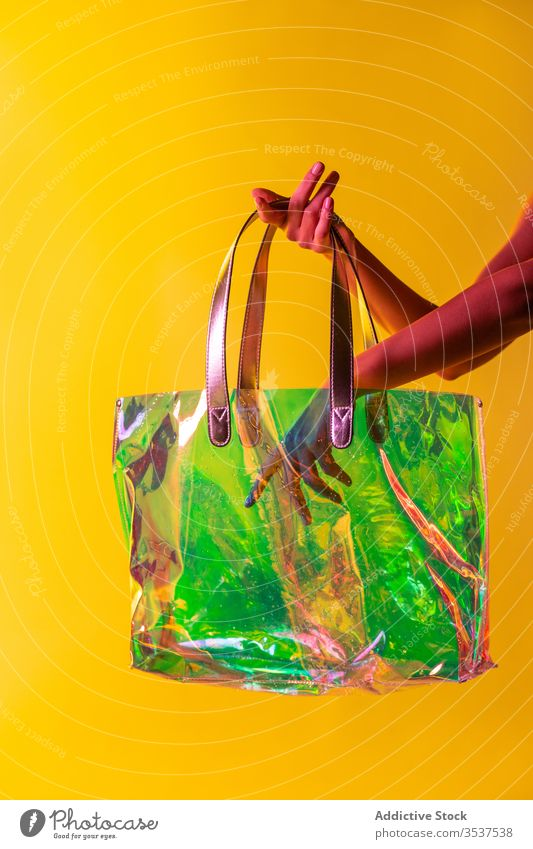Crop woman with stylish plastic handbag style transparent creative colorful fashion accessory female concept vibrant fancy art trendy bright vivid material