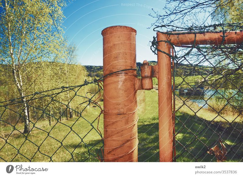 No access Fence Pole Flash photo Metal Wire netting fence Nature Landscape huts Cloudless sky Sunlight Beautiful weather Shadow Grass Light Environment Day Sky