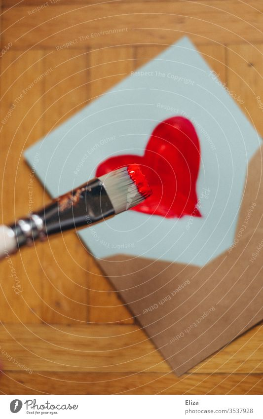 A brush that paints a heart on a letter with red paint Envelope (Mail) Heart Letter (Mail) Love letter Paintbrush Painting (action, artwork) Mother's Day