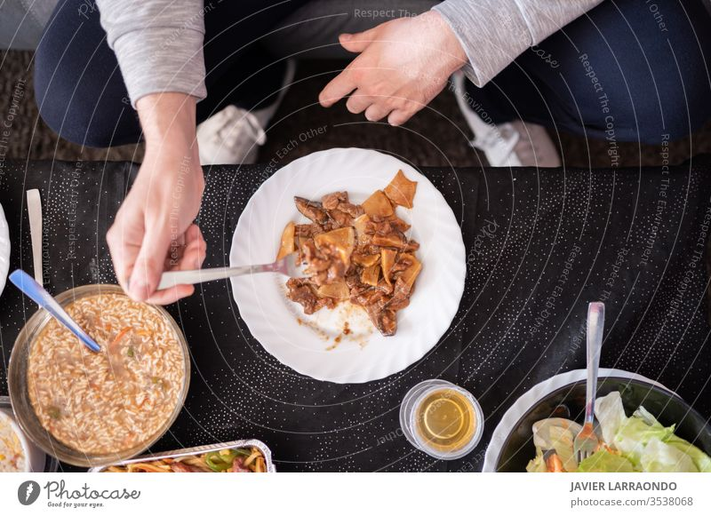 Eating chinese delivery food at home .Top view.Relax time.Enjoy the weekend.Enjoy the isolation. away background chinese food comfortable container couch