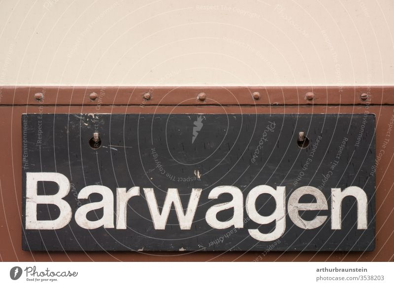 Shield of bar car of an old railway Inscription Beige Brown sign Black Blackboard Drinking rations weigh wagon Train Train compartment Railroad Railroad car