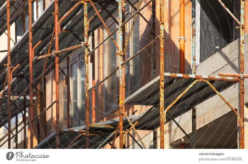 Image of scaffolding on a construction site industry work architecture development engineering structure concrete high industrial estate cement equipment