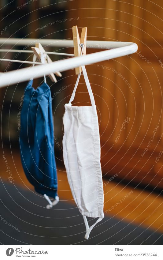 Two face masks hang on the clothes drying rack after washing fabric mask Face mask Wash 60 degrees Mask Cloth Community mask Blue Cotheshorse Washer
