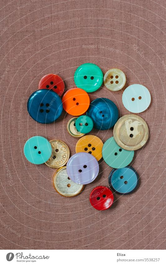 Various colorful buttons on pink background Buttons variegated diverse Sewing Collection Handcrafts Tailor Craft (trade) colourful Round amass Tailor's shop