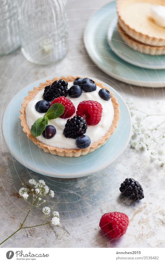 Tartlet with berries on a small turquoise plate Berries baked Dessert Baking Colour photo Baked goods Food photograph Blueberry Raspberry Cake Delicious