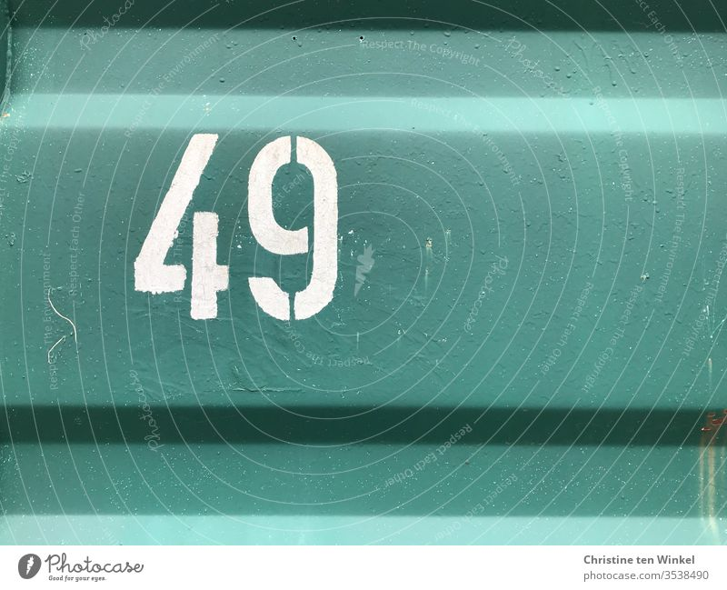 Number 49 - white number on the wall of a green container Digits and numbers Numbers and numbers Signs and labeling Container White container wall metal wall