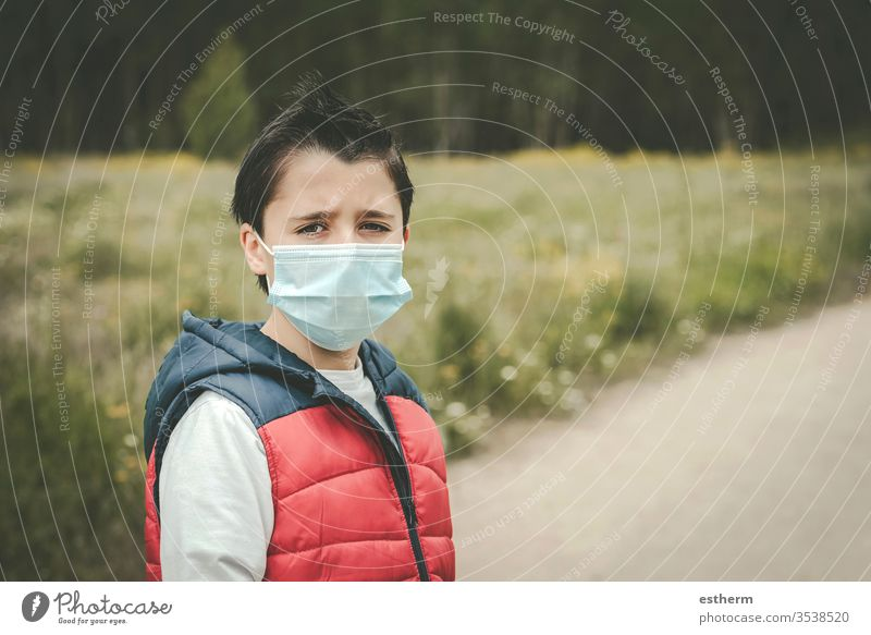 Coronavirus,sad kid wearing medical mask coronavirus child epidemic pandemic thoughtful quarantine covid-19 symptom medicine health death protect childhood