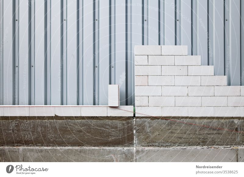 Vocational training as a bricklayer Copy Space bottom Deserted Structures and shapes Pattern Exterior shot Subdued colour Colour photo Mortar