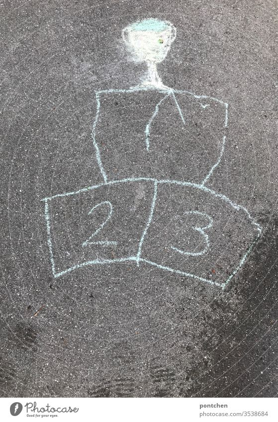 Victory podium and cup painted with street chalk. numbers 1,2 and 3. sports competition victory staircase Children's game Sports Cup (trophy) figures inversely
