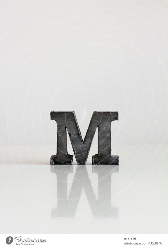 M wie... Elegant Style Leisure and hobbies Sign Characters Signs and labeling Gray Mirror image Reflection Letters (alphabet) White Typography Colour photo
