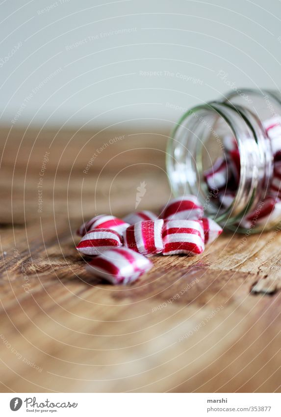 peppermint Food Candy Nutrition Eating Glass Red White Striped Sweet Tasty Wooden table Delicious Calorie Colour photo Interior shot Close-up Detail