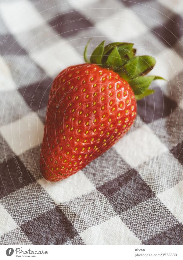 Strawberry Lying On A Kitchen Towel