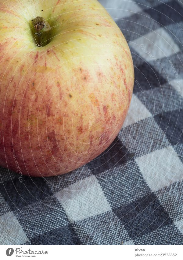 Close up of an apple Apple Detail Fruit vitamins Kitchen kitchen towel Nutrition Colour photo Healthy Fresh Delicious Food Vegetarian diet Diet Red