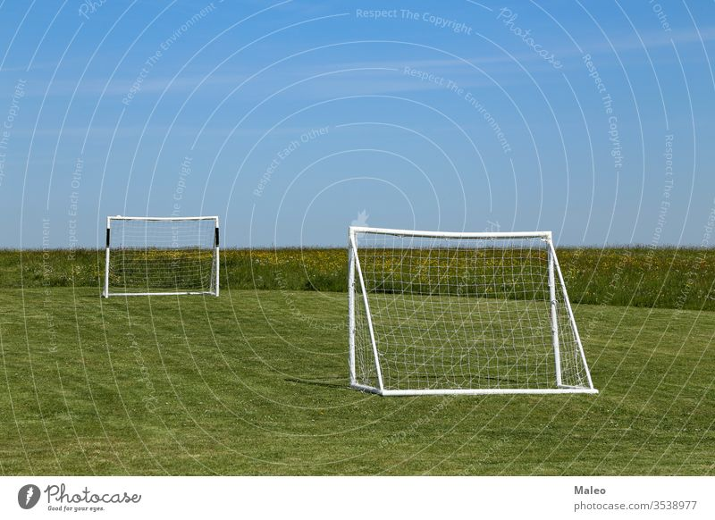 Football goal stand on a green lawn soccer field football gate net grass playground stadium competition game leisure sport turf night backgrounds europe fun
