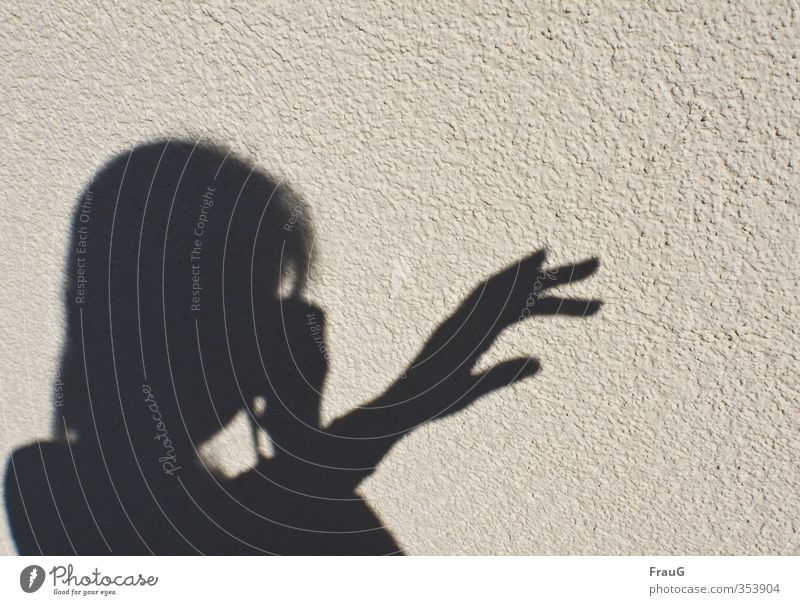 shadow plays Feminine Woman Adults Head Hand Fingers 1 Human being 45 - 60 years Beautiful weather Facade Black Take a photo Shadow Indicate Shadow play
