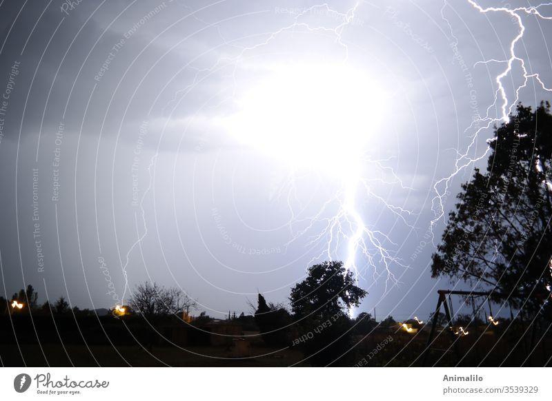 Thunderstrike Thunder and lightning thunderstorm thunderstrike Storm Summer night Meteorology Weather
