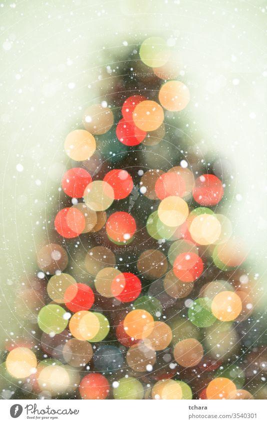 Christmas tree background with snowfall and bokeh lights decorate festive vibrant illumination vivid magic beauty celebrate shapes ornament smooth glittering