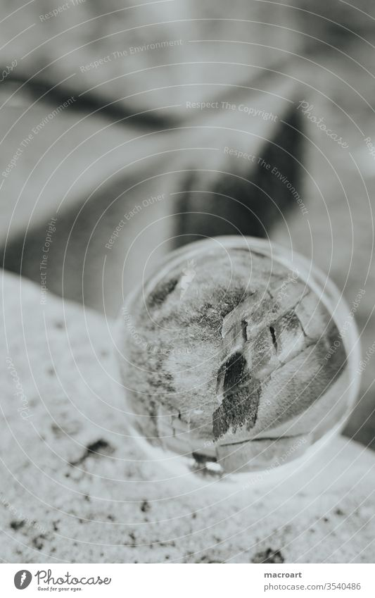 Glass ball image globe photo crystal ball image through glass On the head Sphere Round mirrored Stone Close-up stones Wall (barrier) stone pillars columns