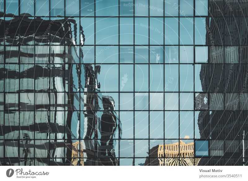 Office buildings reflected over an urban glass facade abstract abstract photography afternoon architectonic architectural architecture building design