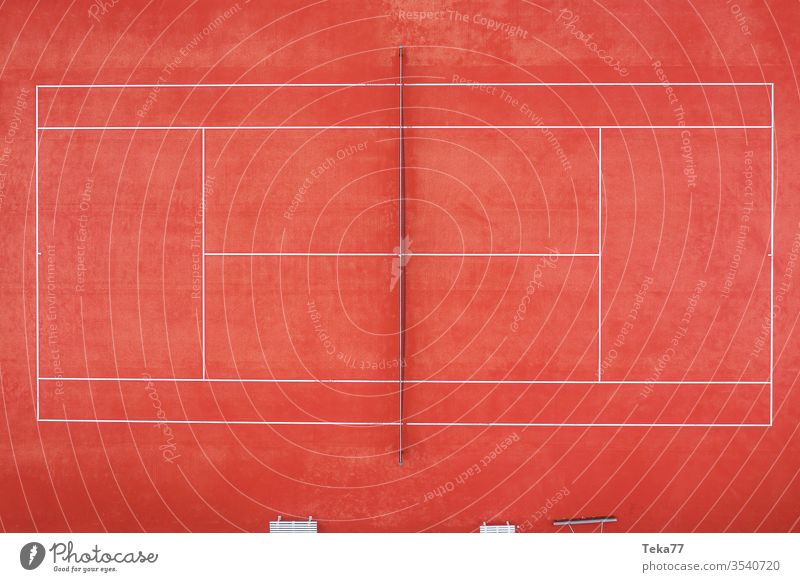 an empty tennis court from above sport sports tennis courts ash orange white lines sun shadow summer winter sharp tennis net tennis nets ball balls tennis ball