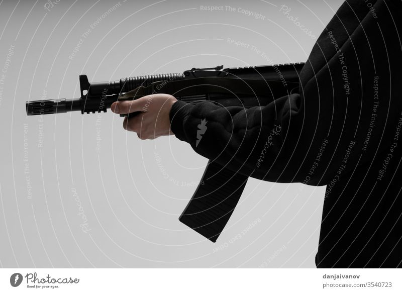 Man in mask With gun on white background weapon hand rifle pistol handgun military shooting isolated danger crime black army soldier war aiming violence armed