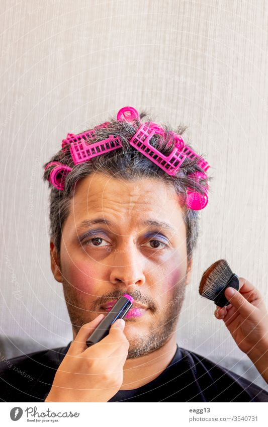 Handsome father is being makeup by the hands of his daughters affectionate bonding brush carefree colors connection cosmetic crazy creativity dad daddy