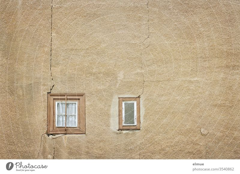 two tiny, whole wooden windows in a sand-coloured wall with cracks Window dilapidated Curtain Decline Diminutive Crack & Rip & Tear object of speculation