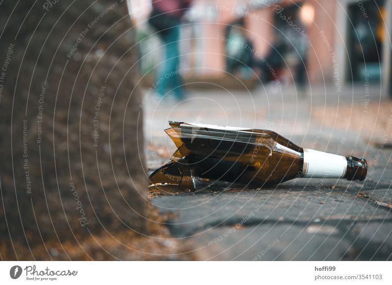 broken bottle on cobblestone shards broken glass Broken broken down Bottle of beer