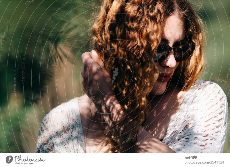 young woman with sunglasses and red curly hair averts the gaze red hair red lips Curl Red-haired Woman already portrait Face Lips Lady Easygoing