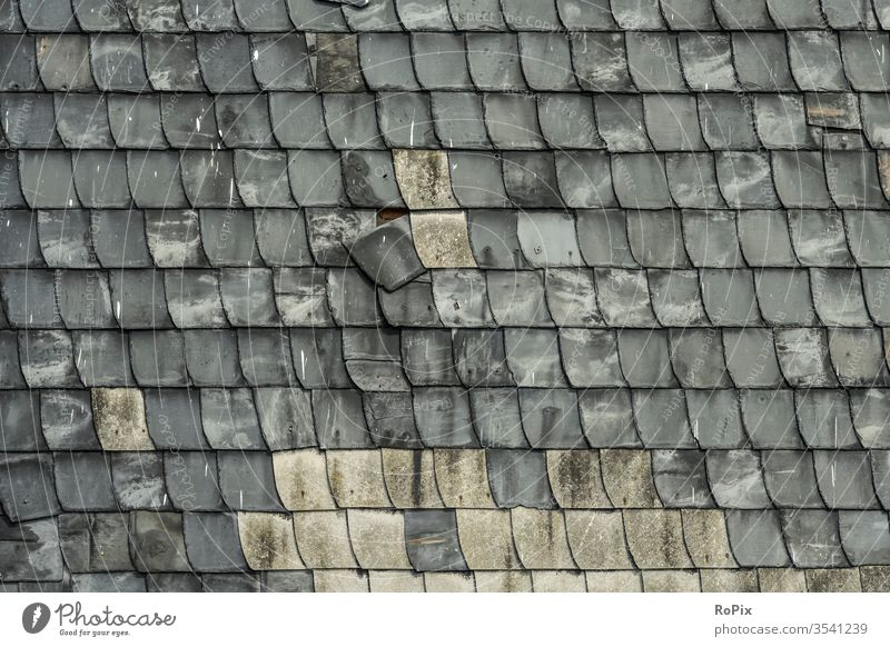 Slate shingles on an old façade. masonry slate reinforcement Stone Natural stone Stone wall Wall (building) rampart Manmade structures Architecture texture