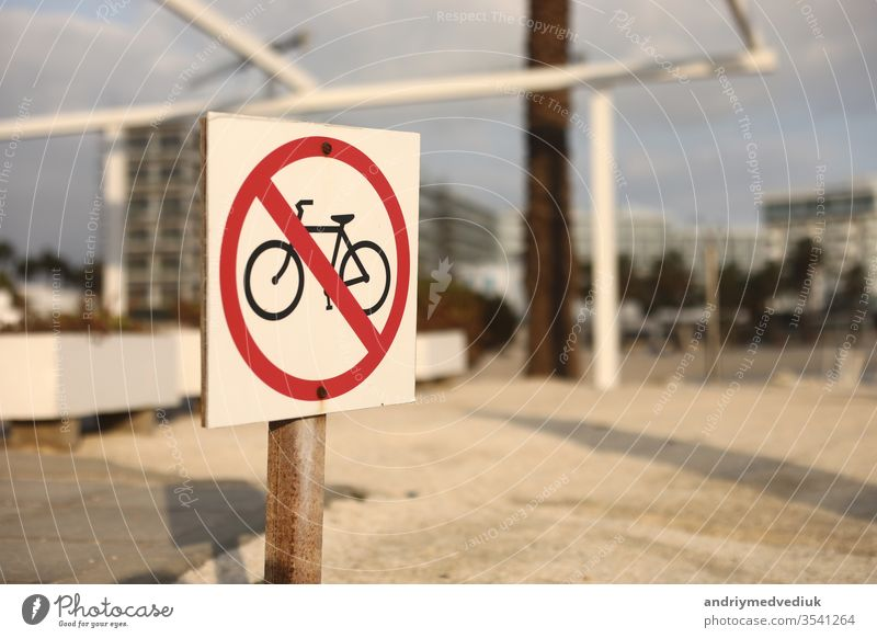 beach traffic sign not to enter with a bicycle. selective focus. the sign on the beach is prohibited by bicycle bike symbol red transportation warning forbidden