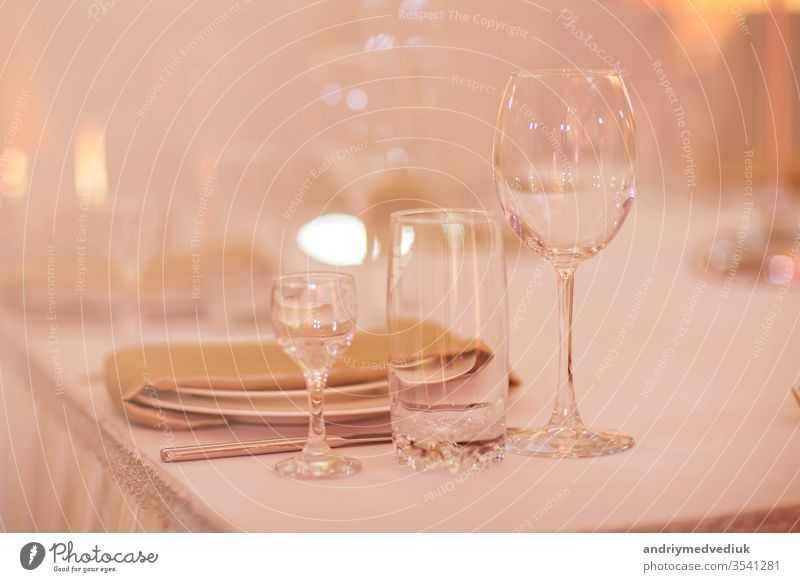 Close up picture of empty glasses in restaurant. Selective focus. empty glasses on the table fancy wine fine set cutlery lunch dinner plate banquet elegant