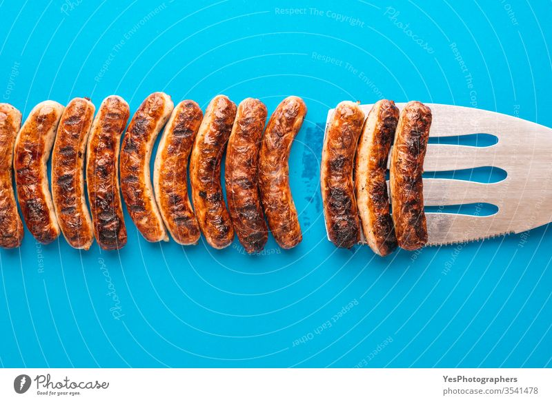 Grilled german sausages. Nuremberger bratwurst. above view authentic barbeque bavaria bavarian bbq blue background brown christmas cooked cuisine delicious