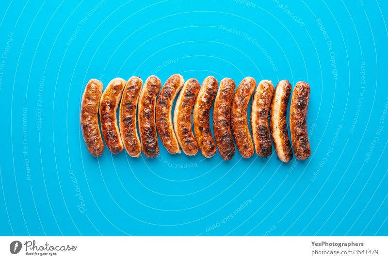 Grilled nuremberger bratwurst. German sausages top view above view authentic barbeque bavaria bavarian bbq blue background brown christmas cooked cuisine