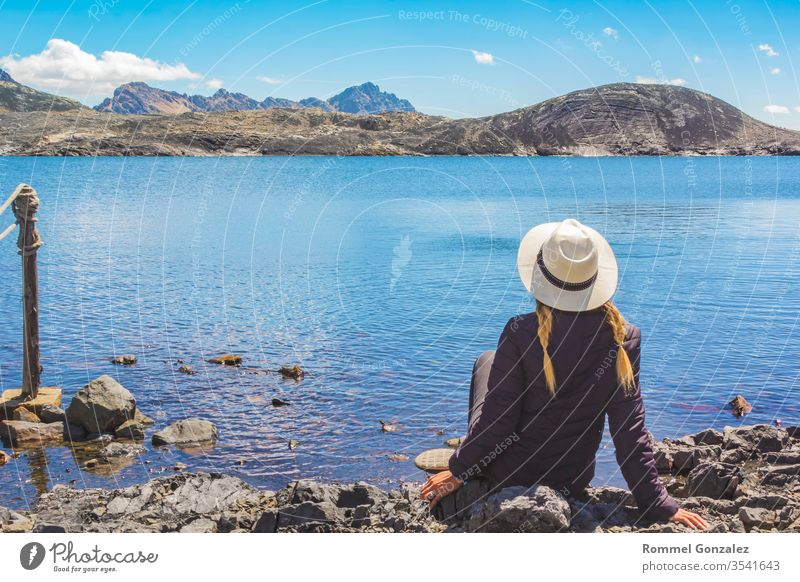 Beautiful woman enjoying landscapes the lagoon of Llanganuco, Huraz. Peru. relax outdoor scenics destination leisure vacations happiness people traveling