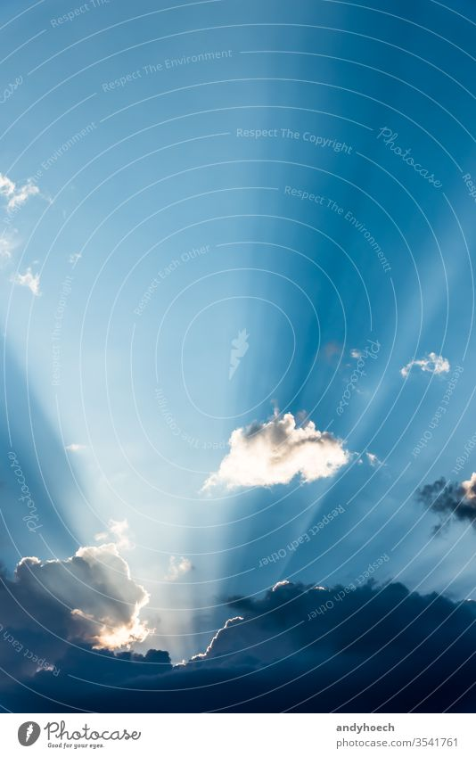 A sunbeam looks out from behind the clouds abstract air atmosphere Background beautiful beauty blue bright chance climate cloudscape cloudy copy space day