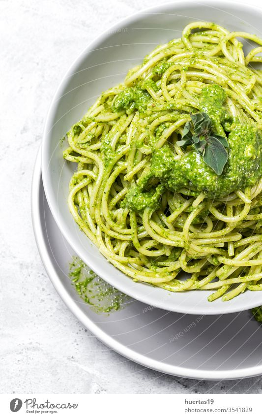 Spaghetti with homemade pesto sauce on gray background spaghetti food plate pasta healthy italian Italian food willow green gourmet cheese organic vegetable