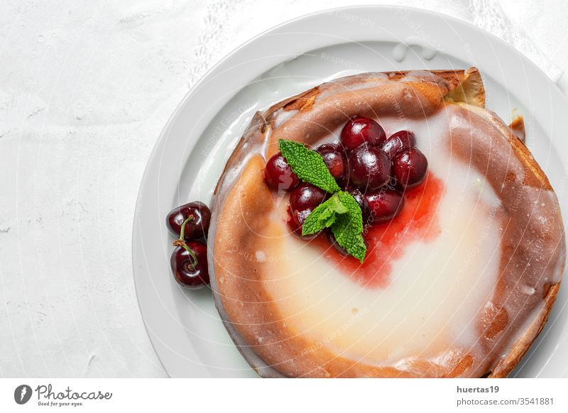 Homemade cheesecake with cherries and mint on white background homemade cherry cherry cheesecake sweet fruit dessert food red berry tasty gourmet cream eat