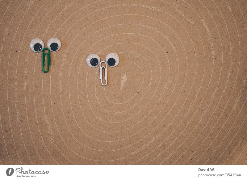 two paper clips look into the camera - big eyes / faces Face peep Observe wittily creatively saucer-eyed inquisitorial Infancy Cute Creativity Figures creatures
