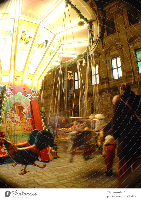 Carousel at night 2 Night Child Rotate Light Long exposure Portrait format Leisure and hobbies Joy Crisis child market Erlangen Christmas & Advent