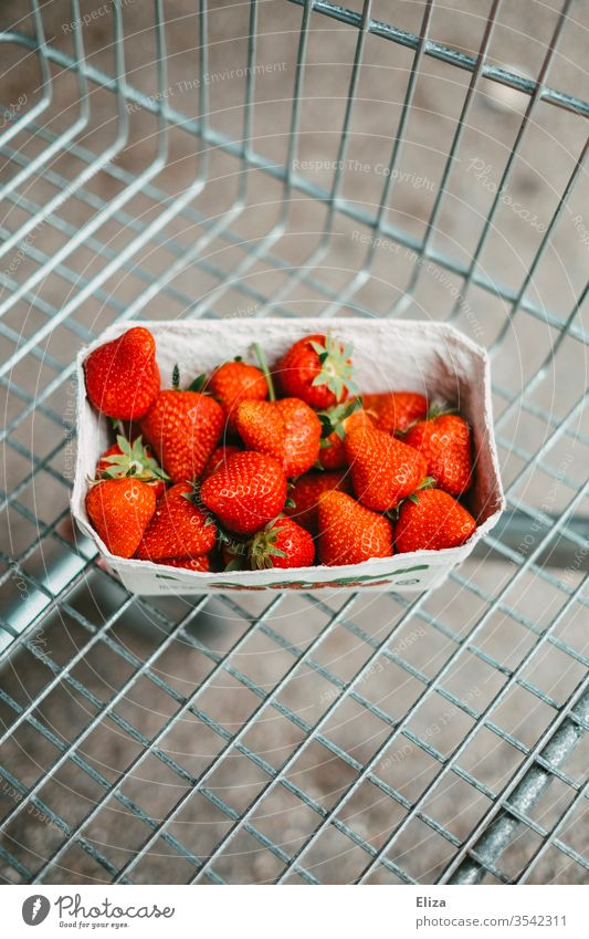 A bowl of fresh strawberries in a shopping trolley Strawberry shell Fresh Shopping Trolley Supermarket Food fruit fruits Mature Healthy Eating Delicious Red