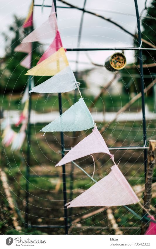A colourful pennant chain as decoration in the garden Decoration Garden variegated cloudy Gray prettify embellish dreariness Feasts & Celebrations