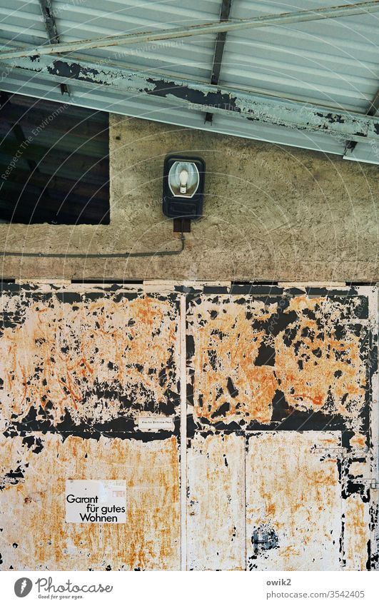 Advertising concept Garage Goal Tin Metal Rust Old Transience Trashy Wall (building) Corner Lamp Detail Roof Corrugated iron roof Pitch of the roof Tracks