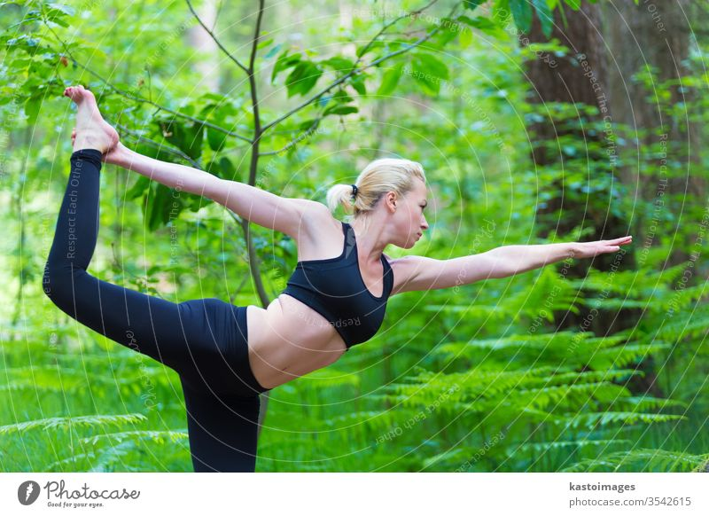 Lady practicing yoga in the nature. outdoor park woman harmony balance pose relaxation female healthy exercise girl lifestyle young person meditation body