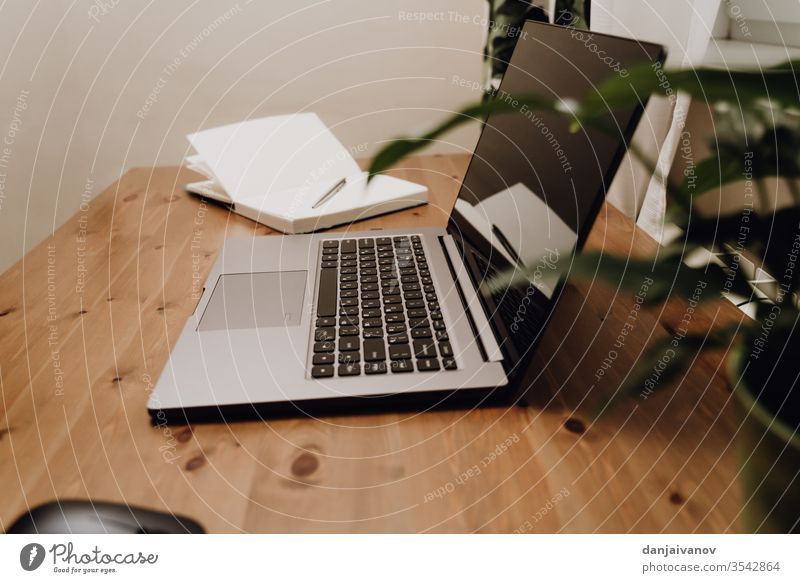 An open laptop to an old wooden table. computer business keyboard office notebook technology desk white screen internet isolated pc monitor work desktop