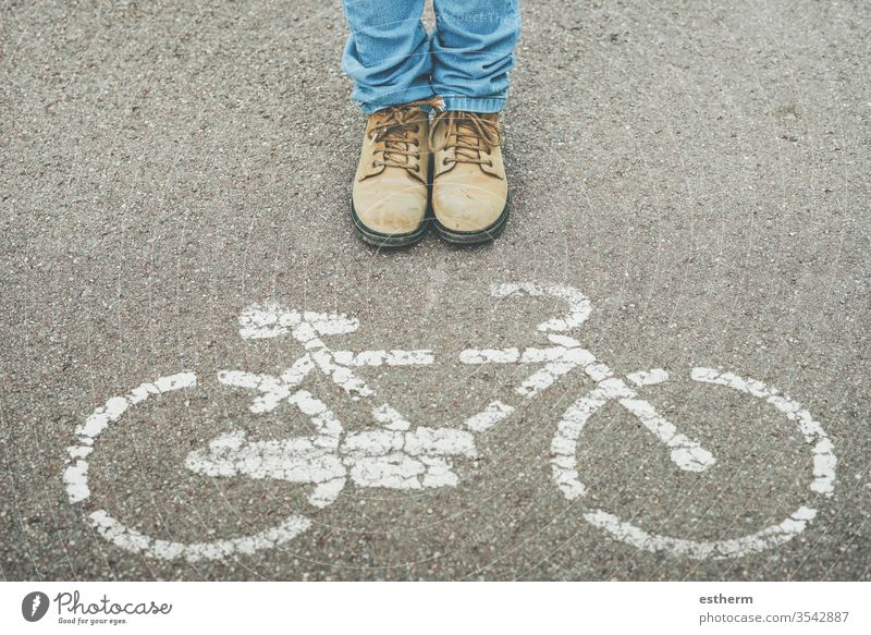chil next to Bike Symbol on Street street urban bike cycle bicycle cyclist rider biker shoe people hobby warning healthy cycling walk pavement icon shoes