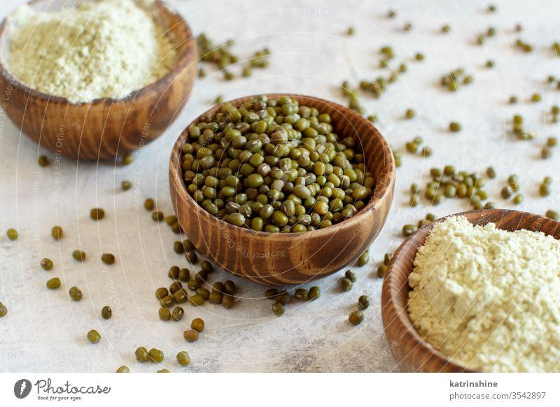 Mung beans flour and grain in bowls raw dry mung alternative flour food ingredient gluten free concept close up rustic cuisine healthy heap pile diet edible