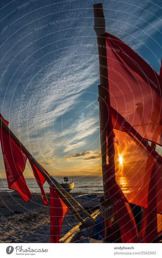 The flags of the fishing boat in front of the sunlight baabe baltic sea beach beautiful beauty cloud clouds coastline craft early fishnet freedom heaven horizon